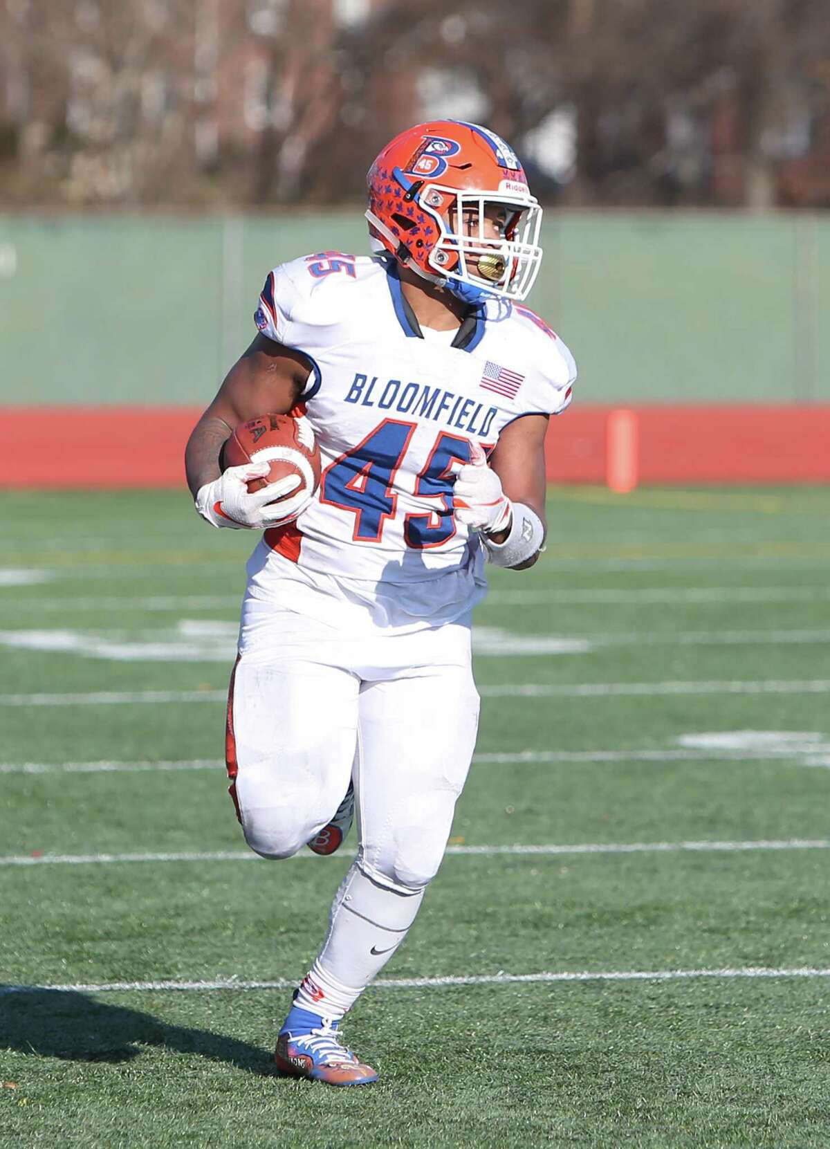 Bloomfield High School?'s Ky?'Juon Butler runs the ball up the field during the Class S Championship Game in New Britain against Haddam-Killingworth High School on Saturday, Dec. 8, 2018.