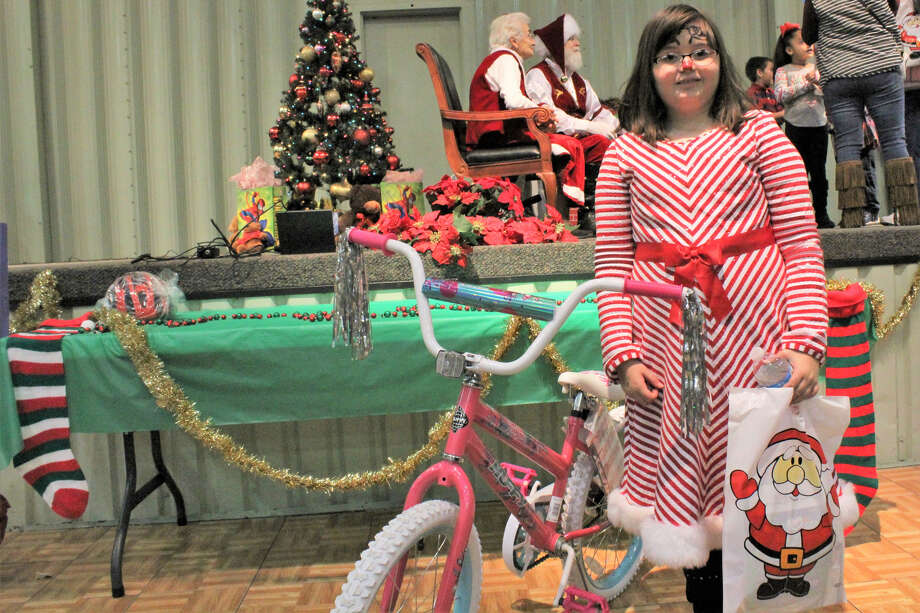 Santa and Mrs. Claus, the guests of honor, attracted long lines of children while parents took photos during the Breakfast With Santa event on Dec. 1. Photo: Aaron Shackelford/courtesy Photo