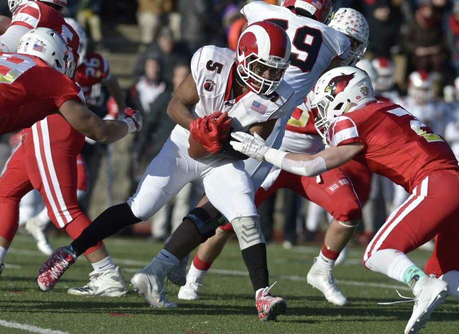 New Canaan's J.R. Moore (5) runs into Greenwich's Evan Weiold (2) in the Connecticut high school Class LL football championship game between Greenwich and New Canaan high schools, Saturday morning, December 8, 2018, at Boyle Stadium, Stamford High School, Stamford, Conn. Photo: H John Voorhees III / Hearst Connecticut Media / The News-Times