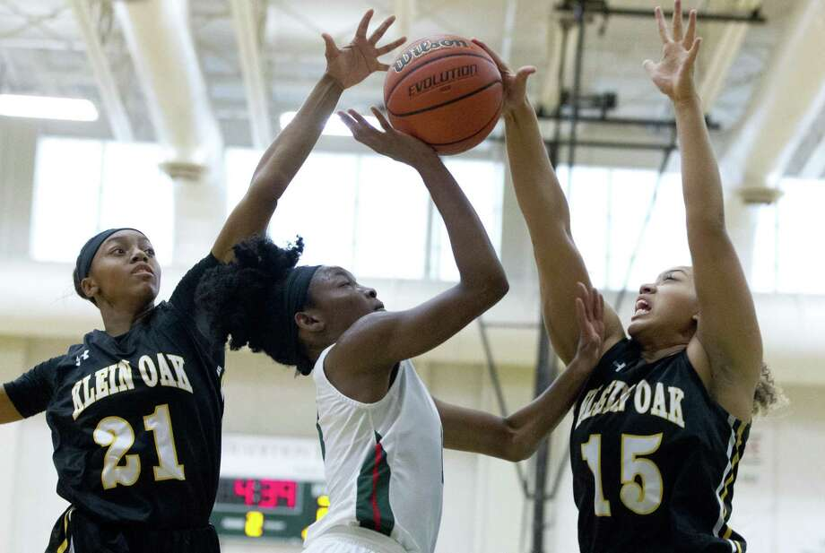 The Woodlands forward Joanne Gabriel (13) has her shot blocked by Klein Oak power forward My'a Bolding (15) as power forward Ashlyn Jones (21) gives pressure during the second quarter of a District 15-6A high school girls basketball game at The Woodlands High School, Saturday, Dec. 8, 2018, in The Woodlands. Photo: Jason Fochtman, Houston Chronicle / Staff Photographer / © 2018 Houston Chronicle