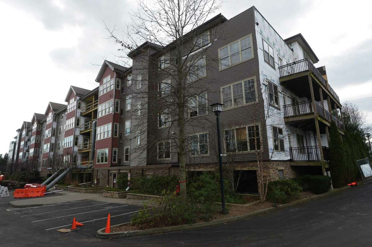 StoneWood Condominiums Thursday, December 6, 2018, in Norwalk, Conn. Nearly a year to the day after fire tore through the upper levels StoneWood Condominiums, a four-story building at 100 Richards Ave., destroying parts of the roof and leaving smoke and water damage in other portions of the 54-unit complex, residents are still waiting to return