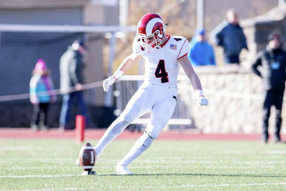Drew Guida (4) of New Canaan starts the game by kickoff during the Class LL state championship game between on New Canaan and Greenwich on December 8, 2018 at Stamford High School in Stamford, CT.