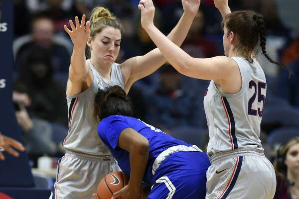 Connecticut's Katie Lou Samuelson (33) and Kyla Irwin (25) double team Seton Hall's Femi Funeus (15) in the second half of an NCAA college basketball game, Saturday, Dec. 8, 2018, in Hartford, Conn. UConn won 99-61. (AP Photo/Stephen Dunn)