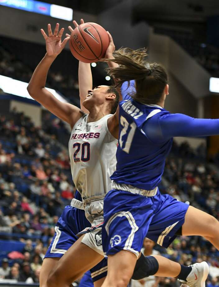 Connecticut's Mikayla Coombs (4) is fouled by Seton Hall's Nicole Jimenez (21) in the second half of an NCAA college basketball game, Saturday, Dec. 8, 2018, in Hartford, Conn. UConn won 99-61. (AP Photo/Stephen Dunn) Photo: Stephen Dunn/AP