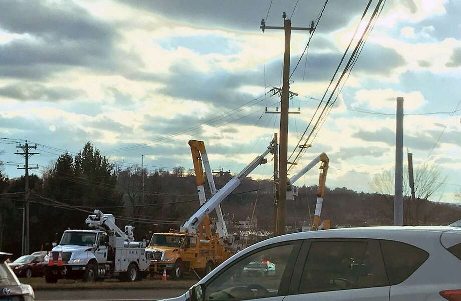Crews seen making repairs to a pole in Danbury, Conn., on Dec. 8, 2018. Photo: Tara O'Neill / Hearst Connecticut Media / Connecticut Post