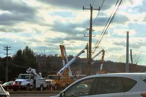 Crews seen making repairs to a pole in Danbury, Conn., on Dec. 8, 2018.