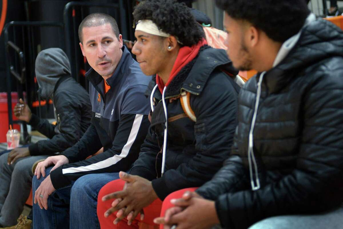 Stamford High School Athletic Director Chris Passamano chats with students at Stamford High School Thursday, December 6, 2018, in Stamford, Conn. Passamano has started a program that provides free meals to Stamford HS students and athletes who need a meal after school before games.