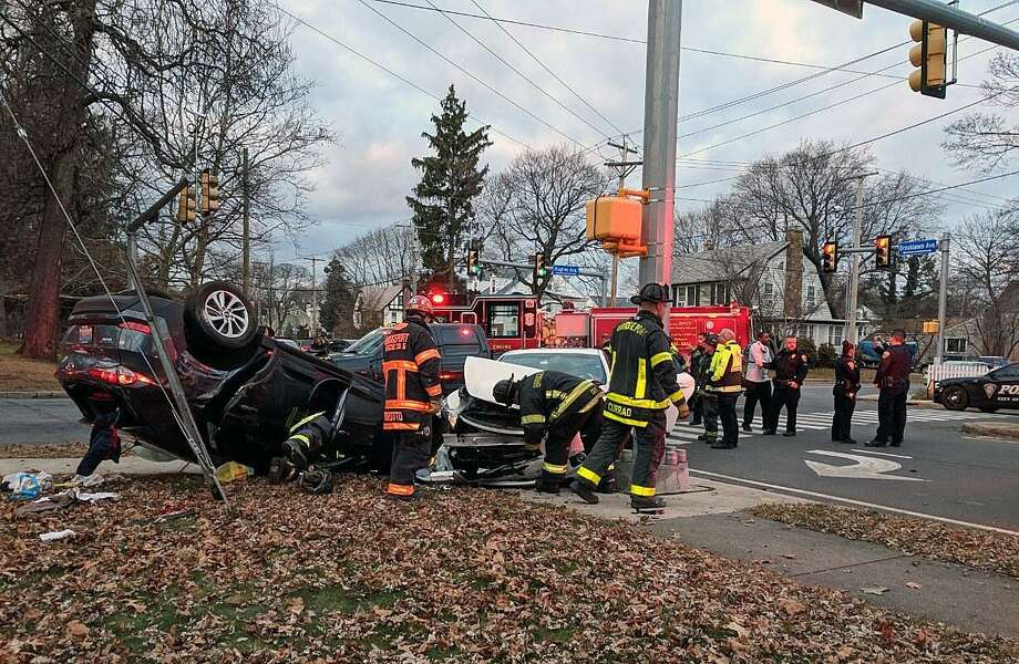 At 4 p.m. on Dec. 8, 2018, Bridgeport, Conn., police and fire units rushed to the 300 block of Brooklawn Avenue, between Laurel Place and Hughes Avenue, for a report of a car that flipped over with someone trapped inside. Photo: Contributed Photo / Contributed Photo / Connecticut Post Contributed