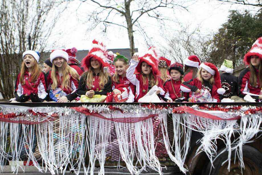 Children with Danzco Dance Academy wave and yell merry Christmas from their float during the Montgomery Christmas Celebration parade Saturday, Dec. 8, 2018 in Montgomery. Photo: Cody Bahn, Houston Chronicle / Staff Photographer / © 2018 Houston Chronicle