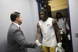 CARSON, CA - SEPTEMBER 30: CEO Jed York of the San Francisco 49ers greets Reuben Foster #56 in the locker room following the game against the Los Angeles Chargers at StubHub Center on September 30, 2018 in Carson, California. The Chargers defeated the 49ers 29-27. (Photo by Michael Zagaris/San Francisco 49ers/Getty Images)