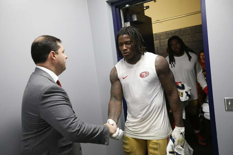 49ers Jed York greets Reuben Foster in the locker room in September, before Foster's latest woe. Photo: Michael Zagaris / Getty Images
