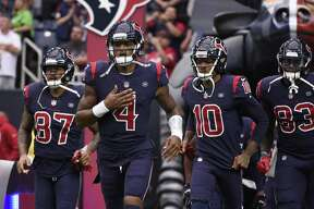 Houston Texans Demaryius Thomas (87), Deshaun Watson (4), DeAndre Hopkins (10) and Jordan Thomas (83) before an NFL football game against the Cleveland Browns, Sunday, Dec. 2, 2018, in Houston. (AP Photo/Eric Christian Smith)