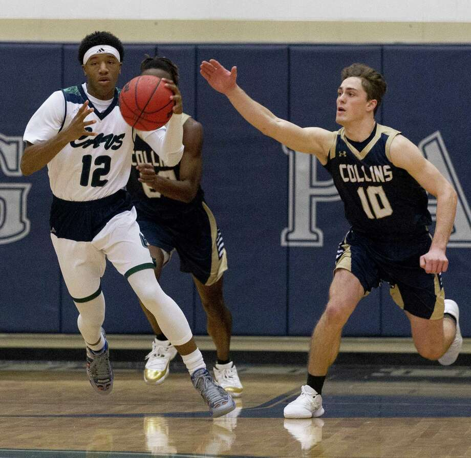 College Park guard Tyren Montgomery (12) starts a fast break during the first quarter of a District 15-6A high school basketball game at College Park High School, Saturday, Dec. 8, 2018, in The Woodlands. Photo: Jason Fochtman, Houston Chronicle / Staff Photographer / © 2018 Houston Chronicle