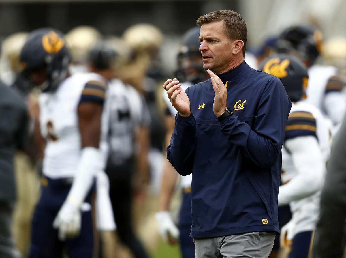 FILE - In this Oct. 28, 2017, file photo, California head coach Justin Wilcox claps during the first half of an NCAA college football game in Boulder, Colo. Wilcox has signed a new five-year deal to stay under contract with the school through the 2023 season. The deal signed Thursday, Dec. 6 2018, adds two more years to the original contract signed in 2017. (AP Photo/David Zalubowski, File)