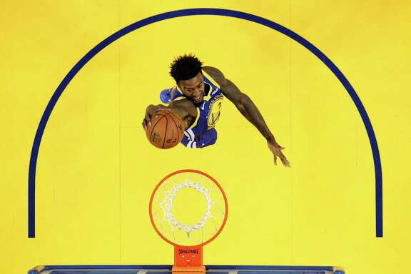 Golden State Warriors Forward Jordan Bell goes in for a dunk during a game against theAtlanta Hawks at Oracle Arena on Tuesday, November 13, 2018.