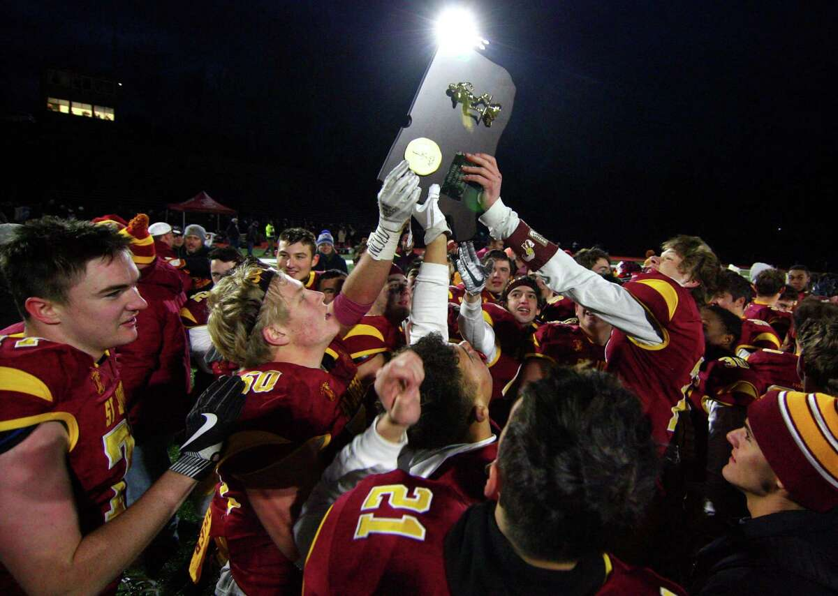 St. Joseph celebrates its win over Berlin in Class M state championship football action in Shelton, Conn., on Saturday Dec. 8, 2018.