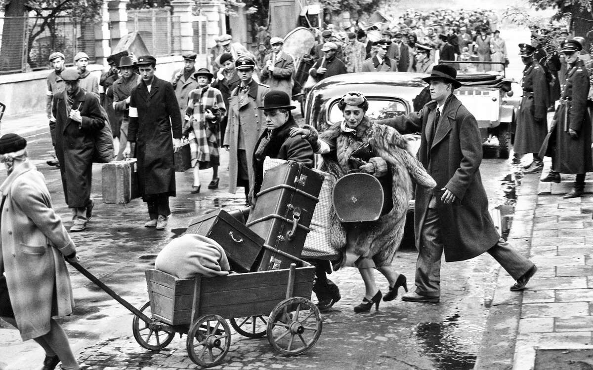 """Jews evacuate their homes in """"Schindler's List,"""" a film where some of the most powerful scenes have no dialogue to convey a larger sense of what was happening beyond the plotline."""