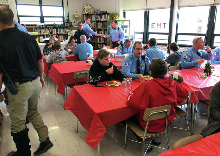 Edwardsville police officers enjoy lunch and the company of Lincoln Middle School eighth-graders during the Lincoln Middle School First Responders' Luncheon this week. Photo: For The Intelligencer