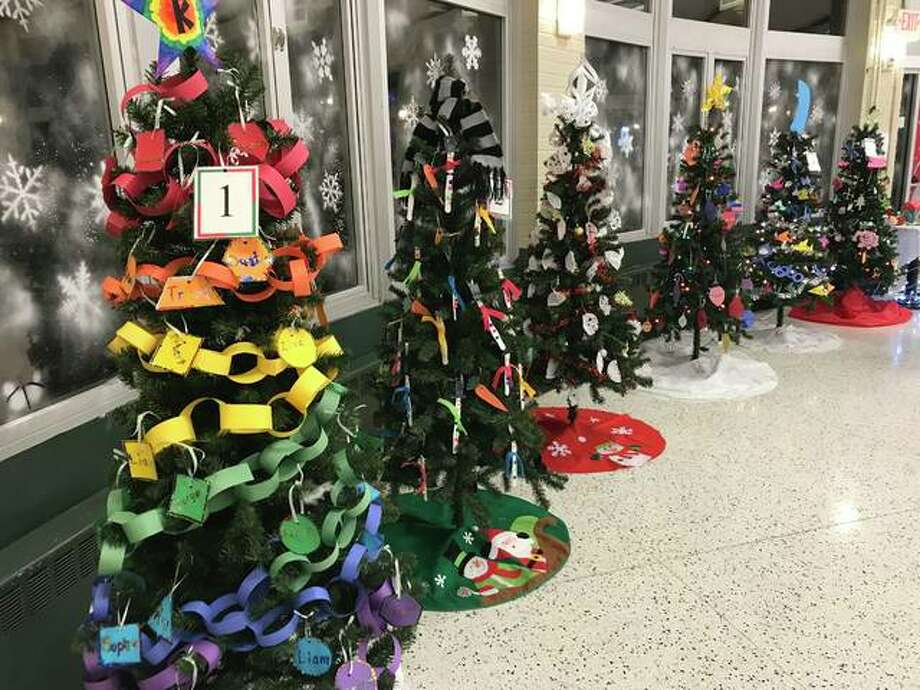 "Christmas trees on display at ""WinterVille Festival."" Tree were decorated by different grade levels of students at Lewis and Clark Elementary"