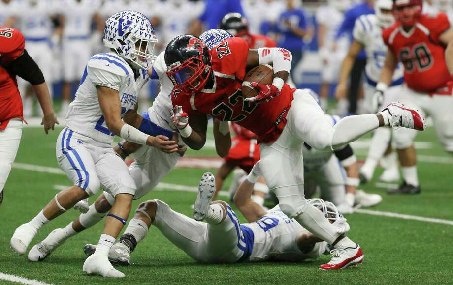 Wagner's L. J. Butler (22) powers his way for yardage against Mission Veterans Memorial's Elias Delgado (27) in the first half in the Region IV-5A Division II final game at the Alamodome on Saturday, Dec. 8, 2018. (Kin Man Hui/San Antonio Express-News) Photo: Kin Man Hui, Staff Photographer / San Antonio Express-News / ©2018 San Antonio Express-News