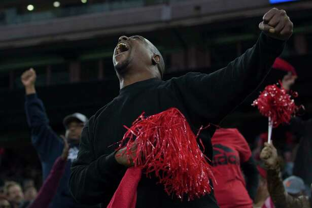 A West Brook fan cheers for the team during the second half of the playoff game against Cy Creek at NRG Stadium on Saturday, Dec. 8, 2018, in Houston. The West Brook Bruins defeated the Cypress Creek Cougars 31-21.