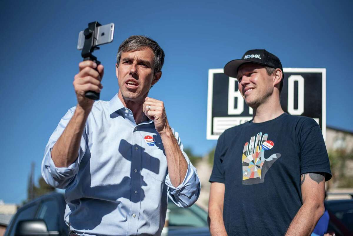 Beto O'Rourke, Democratic candidate for the U.S. Senate, holds a mobile device while speaking to voters outside a polling station in El Paso, Texas, U.S., on Tuesday, Nov. 6, 2018. Today's midterm elections will determine whether Republicans keep control of Congress and will set the stage for President Donald Trump's bid to win re-election in 2020. Photographer: Sergio Flores/Bloomberg