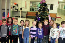 Students at Leclaire Elementary pose in front of the school's Giving Tree Friday. The school, located at 801 Franklin Ave., is currently collecting hats and gloves for children in need. In addition to the hat and mitten tree, Leclaire students also participated in the United Way's Community Christmas collection and are performing random acts of kindness for the month of December. Leclaire Elementary Principal Dr. Cornelia Smith and school staff said the activities emphasize kindness and giving, especially this time of the year.