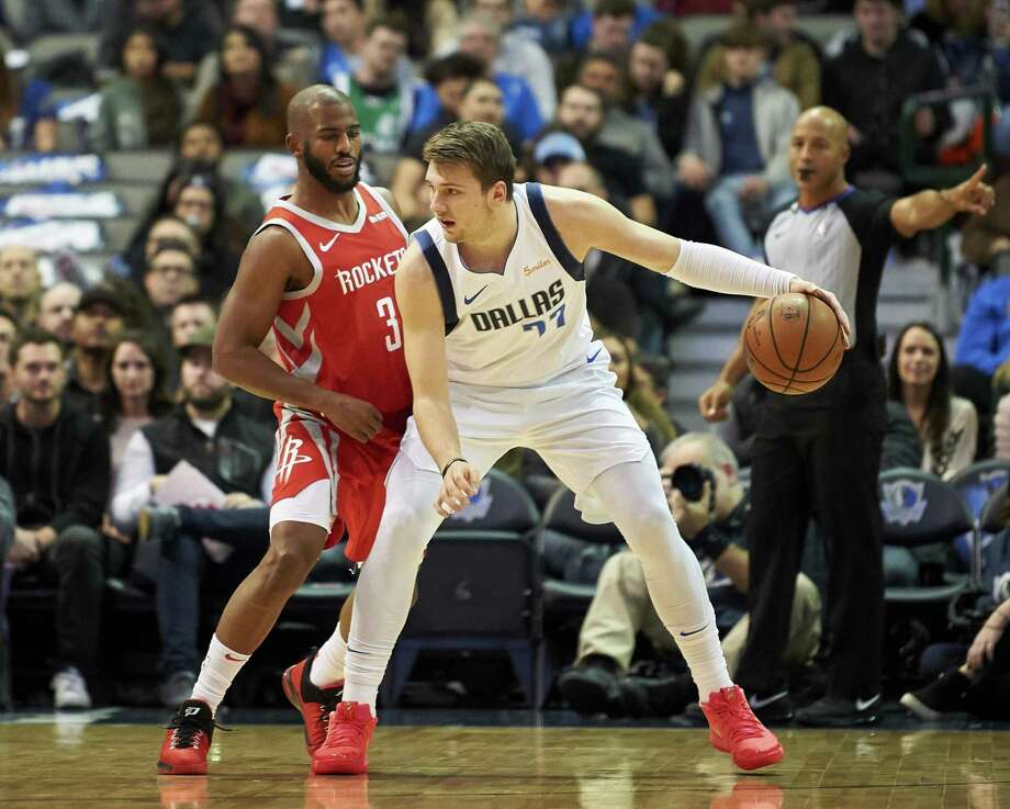 Dallas Mavericks forward Luka Doncic (77) backs down Houston Rockets guard Chris Paul (3) during the first half of an NBA basketball game, Saturday, Dec. 8, 2018, in Dallas. (AP Photo/Cooper Neill) Photo: Cooper Neill, FRE / Associated Press / Copyright 2018 The Associated Press. All Rights Reserved.