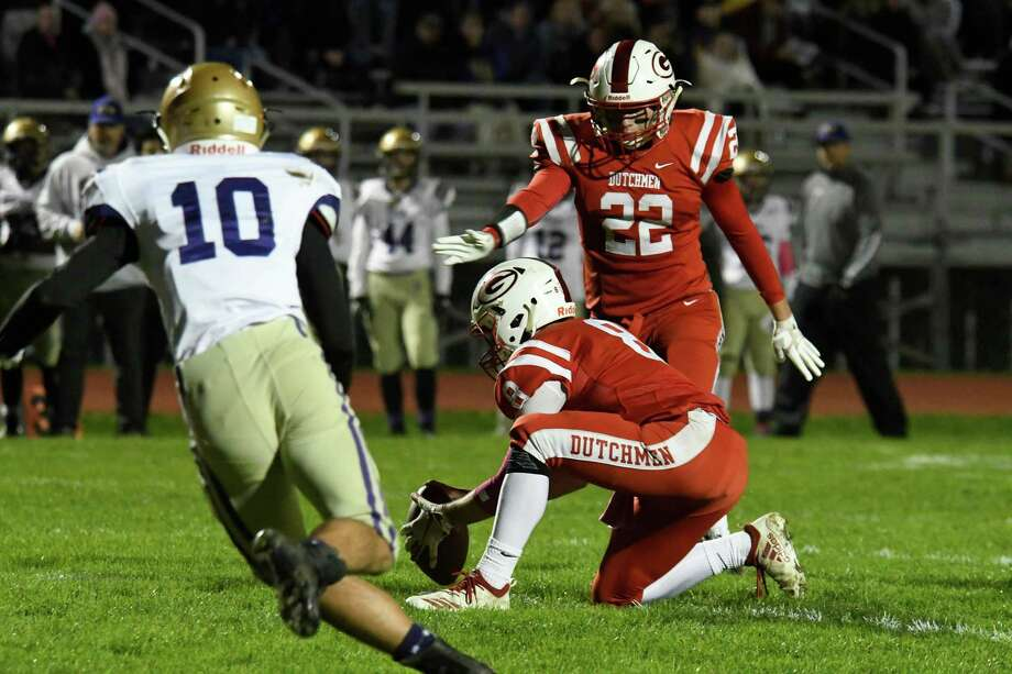 CBA defensive back Dylan Jones runs to block a kick for an extra point from Guilderland tight end Nick Popolizio during a game on Friday, Oct. 19, 2018  in Guilderland, N.Y. (Jenn March, Special to the Times Union ) Photo: Jenn March / © Jenn March 2018 © Albany Times Union 2018