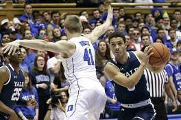 Duke's Jack White (41) guards Yale's Alex Copeland during the first half on Saturday.