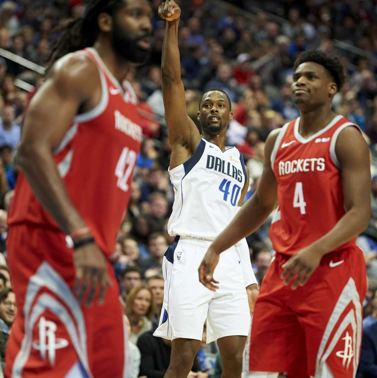 Dallas Mavericks forward Harrison Barnes (40) reacts after making a shot against the Houston Rockets during the second half of an NBA basketball game, Saturday, Dec. 8, 2018, in Dallas. (AP Photo/Cooper Neill)