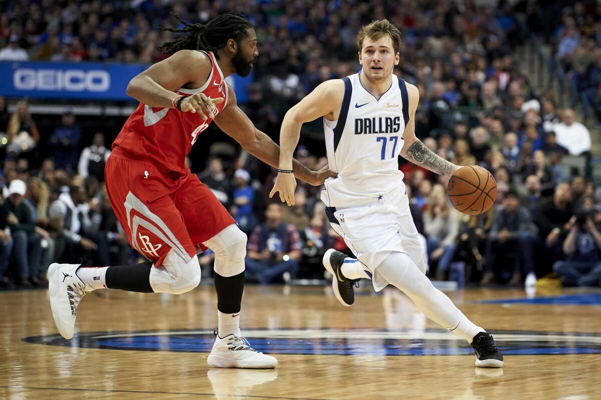 Dallas Mavericks forward Luka Doncic (77) drives to the basket against Houston Rockets center Nene Hilario (42) during the second half of an NBA basketball game, Saturday, Dec. 8, 2018, in Dallas. (AP Photo/Cooper Neill)
