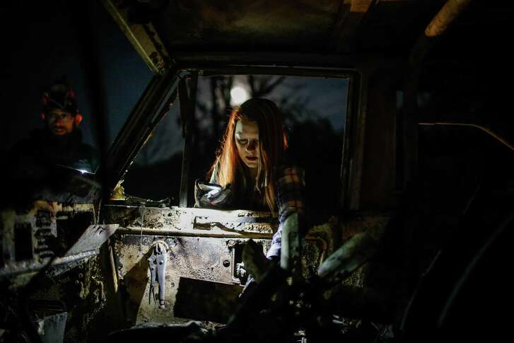 Following the destruction of the Camp Fire in Butte County, Tina Tuel looks through her parents car off of Honey Run Road in Chico on Tuesday, November 20, 2018.