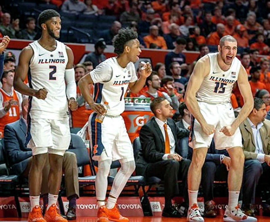 Illinois players, from left Kipper Nichols, Trent Frazier and Giorgi Bezhanishvili celebrate curing their team's victory over UNLV Saturday at State Farm Center in Champaign. The win halted a three-game Illini losing streak. Photo: Edwin Capuli | Illinois Athletics