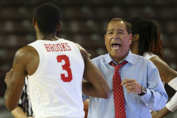 Houston Cougars Head Coach Kelvin Sampson talks to guard Armoni Brooks (3) during the first half of the game against the Alabama A&M Bulldogs at H&PE Arena on Saturday, Nov. 10, 2018, in Houston.