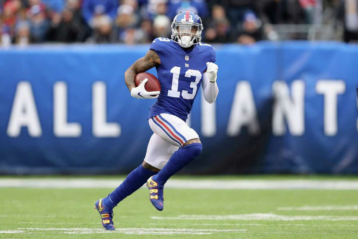 EAST RUTHERFORD, NJ - NOVEMBER 18: Wide receiver Odell Beckham Jr. #13 of the New York Giants carries the ball against the Tampa Bay Buccaneers in the first half at MetLife Stadium on November 18, 2018 in East Rutherford, New Jersey. (Photo by Elsa/Getty Images)