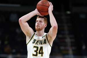 Siena forward Kevin Degnan scores a three pointer during a game against Harvard Saturday Dec. 1, 2018 at the Times Union Center. (Phoebe Sheehan/Special to the Times Union)