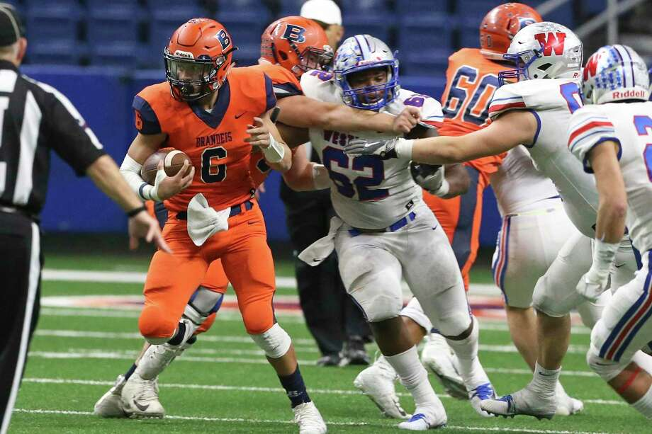 Bronco quarterback Jordan Battles just makes it back to the line of scrimmage on a run as Brandeis plays Westlake in the Region IV-6A Division fianl at the Alamodome on December 8, 2018. / 2017 SAN ANTONIO EXPRESS-NEWS