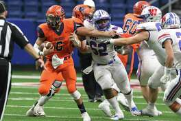 Bronco quarterback Jordan Battles just makes it back to the line of scrimmage on a run as Brandeis plays Westlake in the Region IV-6A Division fianl at the Alamodome on December 8, 2018.
