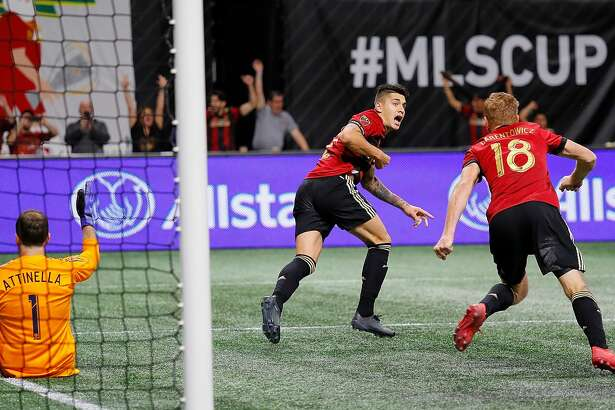 ATLANTA, GA - DECEMBER 08: Franco Escobar #2 of Atlanta United celebrates after scoring the second goal past goalkeeper Jeff Attinella #1 of Portland Timbers in the second half with Jeff Larentowicz #18 during the 2018 MLS Cup between Atlanta United and the Portland Timbers at Mercedes-Benz Stadium on December 8, 2018 in Atlanta, Georgia. (Photo by Kevin C. Cox/Getty Images)