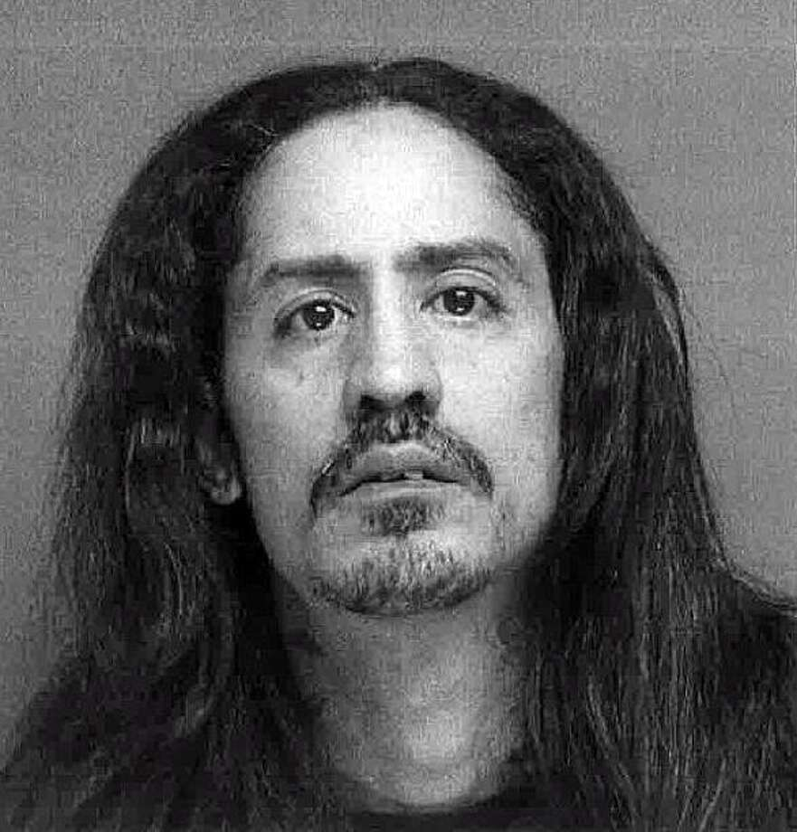 Anthony Velazquez, 43, of Sanford Avenue in Bridgeport, Conn., was charged with criminal possession of a revolver, theft of a firearm, carrying a revolver without a permit, illegal possession of weapons in a motor vehicle and possession of marijuana. Photo: Contributed Photo / Bridgeport Police Department / Contributed Photo / Connecticut Post Contributed