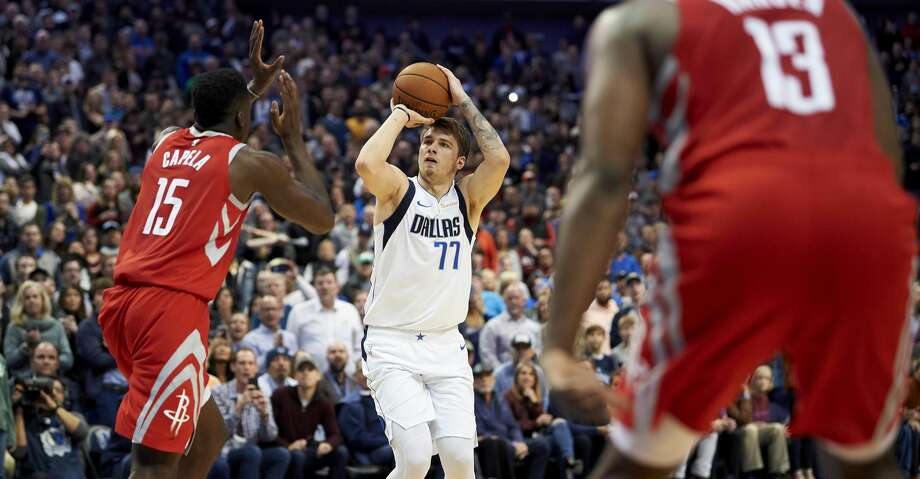 Dallas Mavericks forward Luka Doncic (77) shoots a 3-pointer over Houston Rockets center Clint Capela (15) during the second half of an NBA basketball game, Saturday, Dec. 8, 2018, in Dallas. (AP Photo/Cooper Neill) Photo: Cooper Neill/Associated Press