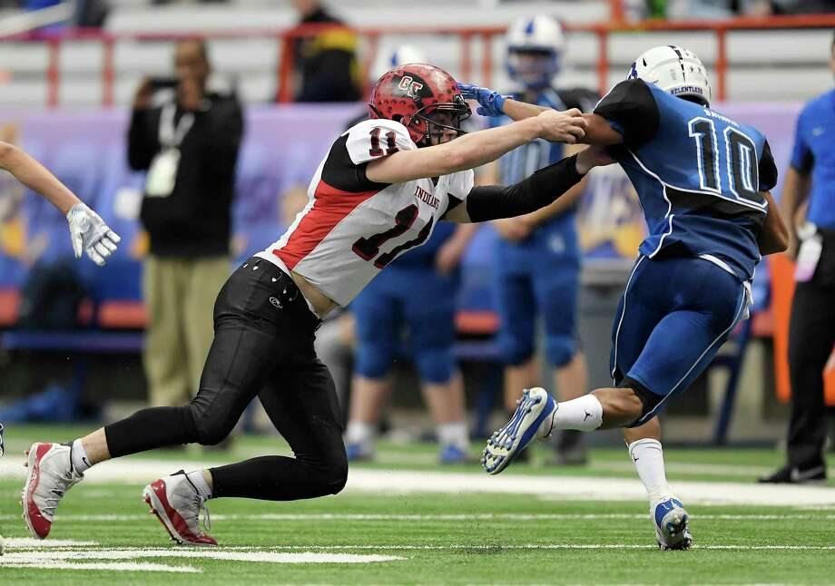 Glens Falls' Joseph Girard III, left, defends against Batavia's Taiyo Iburi-Bethel during the 2018 Class B NYSPHSAA Football Championships in Syracuse, N.Y., Saturday, Nov. 24, 2018. Glens Falls claimed the Class B title with a 55-32 win over Batavia-V. (Adrian Kraus / Special to the Times Union) Photo: Adrian Kraus / © akoPhoto 2018
