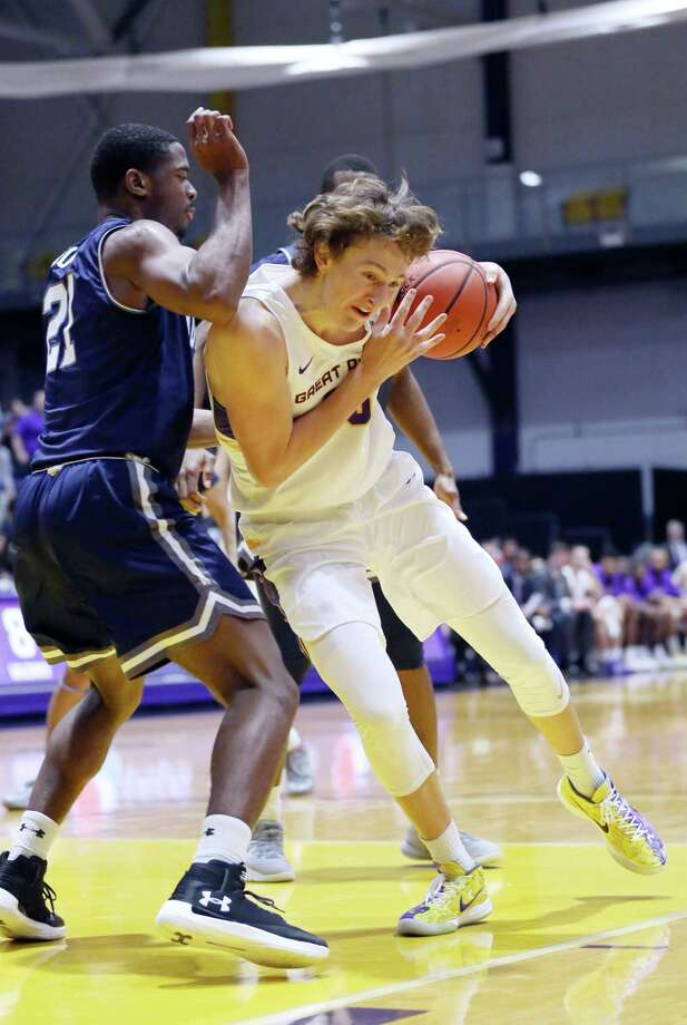 UAlbany forward Sasha French collides with Monmouth forward Nikkel Rutty during a game against Monmouth Saturday Dec. 8, 2018 at the SEFCU Arena. (Phoebe Sheehan/Special to The Times Union) Photo: Phoebe Sheehan