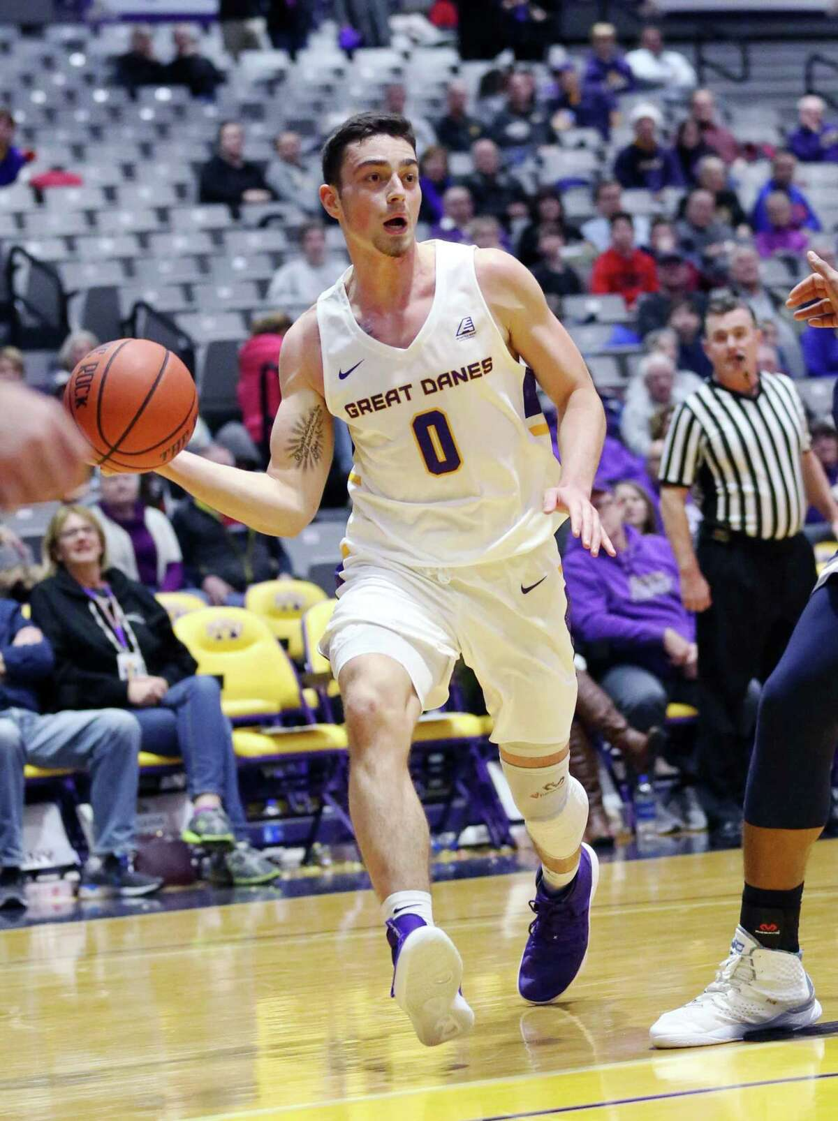 UAlbany guard Antonio Rizzuto passes the ball during a game against Monmouth Saturday Dec. 8, 2018 at the SEFCU Arena. (Phoebe Sheehan/Special to The Times Union)