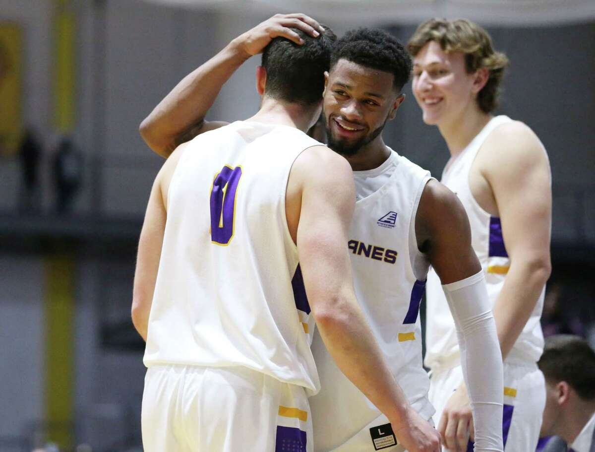 UAlbany guard Ahmad Clark embraces Antonio Rizzuto during a game against Monmouth Saturday Dec. 8, 2018 at the SEFCU Arena. (Phoebe Sheehan/Special to The Times Union)
