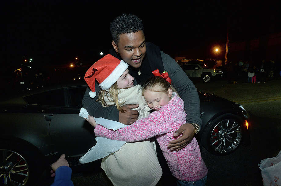"""Deandre Nico, who was recently a contestant on """"The Voice,"""" and was grand marshal ofl the City of Port Arthur's annual lighted Holiday Parade, stops to hug and take pictures with fans as he makes his way down Procter Street.  Photo taken Saturday, December 8, 2018 Kim Brent/The Enterprise Photo: Kim Brent/The Enterprise"""