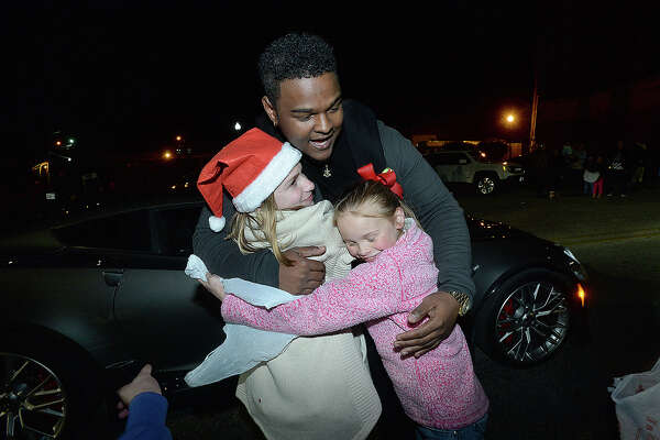 "Deandre Nico, who was recently a contestant on ""The Voice,"" and was grand marshal ofl the City of Port Arthur's annual lighted Holiday Parade, stops to hug and take pictures with fans as he makes his way down Procter Street. Photo taken Saturday, December 8, 2018 Kim Brent/The Enterprise"
