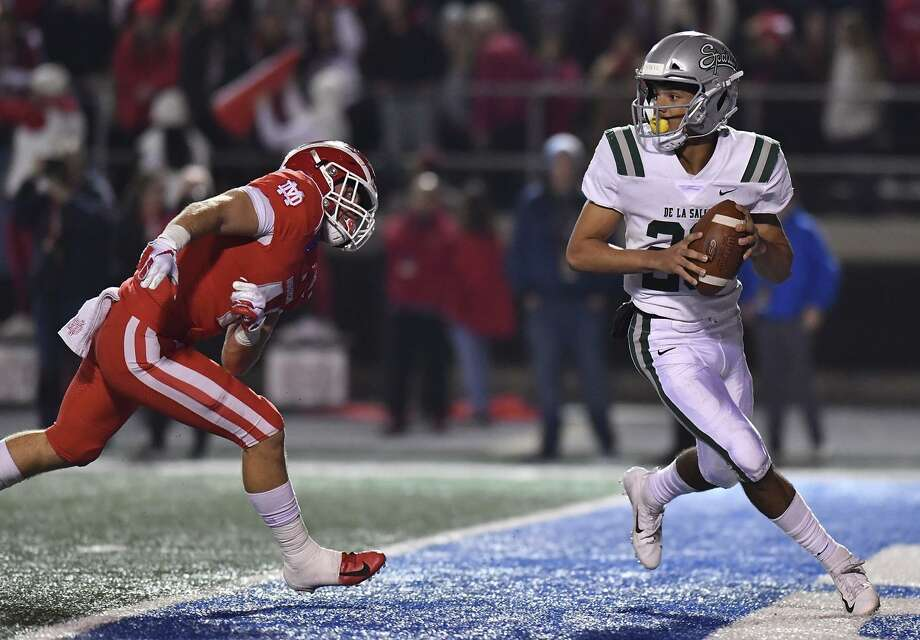 December 8, 2018 Cerritos, CA. Concord De La Salle quarterback Dorian Hale #20 looks to pass while under pressure in the end zone from Mater Dei linebacker Steele Dubar #44 in action during the CIF State Open Division prep football championship game. CIF State Open Division Prep Football Championship. Photo: Louis Lopez / Modern Exposure / Louis Lopez/Modern Exposure