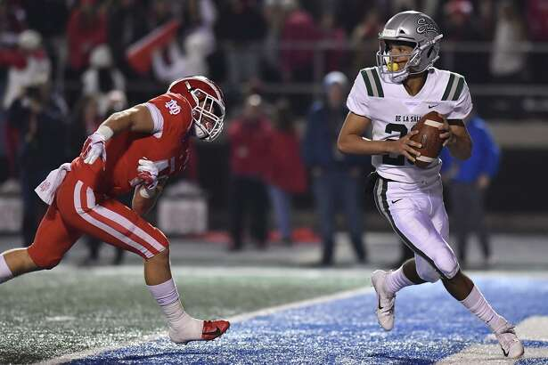 December 8, 2018 Cerritos, CA. Concord De La Salle quarterback Dorian Hale #20 looks to pass while under pressure in the end zone from Mater Dei linebacker Steele Dubar #44 in action during the CIF State Open Division prep football championship game. CIF State Open Division Prep Football Championship.